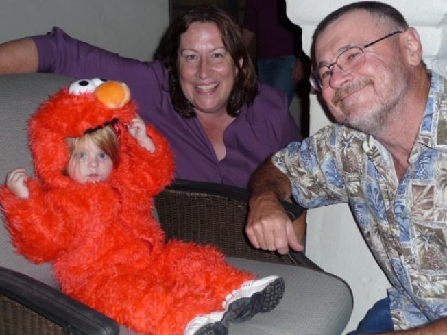 Tigan Farnsworth, a totally cute tottler in the elmo suit, Mary and Carl Watts